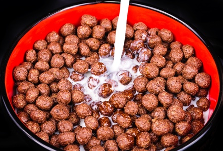 Breakfast cereals, chocolate balls  The photo on black background