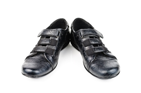 Shoes for children. Black shoes on a white background photo