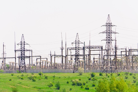 electric grid: Distribution of electricity sub-station. Power transmission towers on the hill