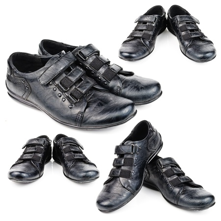 children s feet: Shoes for children. Black shoes on a white background