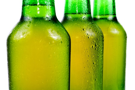 Sweaty bottle of beer. Isolated on white background photo