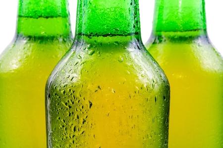Sweaty bottle of beer. Isolated on white background photo