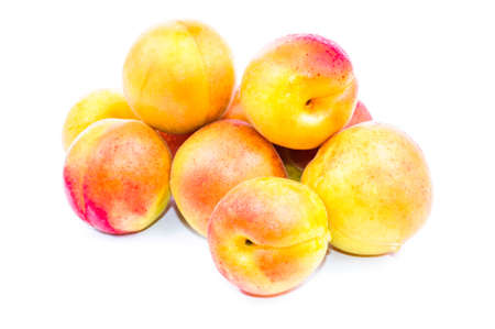 Fruits are ripe apricots. The photo on white background photo