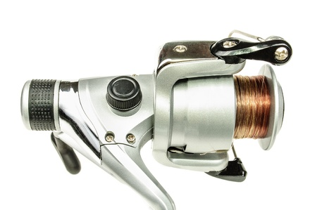 Reel and line for fishing rods  The photo on white background photo