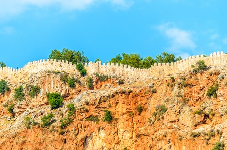 Fragment of the wall of an old fortress  Photo wall on top of a mountain photo