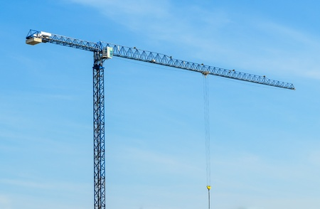 Construction crane. The photo on the background of blue sky photo