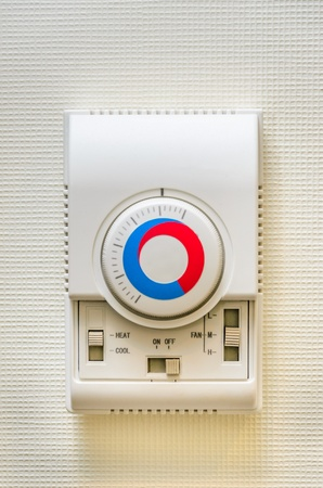 Wall-mounted remote control electric floor heating. Photo Close-up