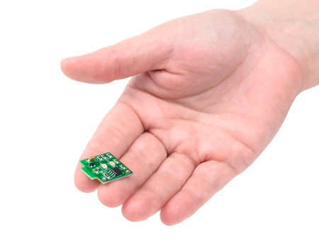 Miniature elctronic circuit board on hand. The photo on the white background photo