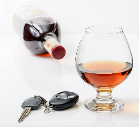 glass of alcohol and car keys. Photo isolated on white background Stock Photo - 17307882