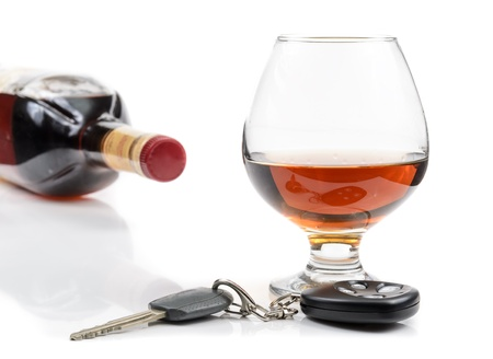 car crime: glass of alcohol and car keys. Photo isolated on white background