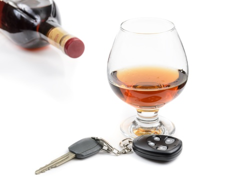 glass of alcohol and car keys. Photo isolated on white background Stock Photo - 17307874