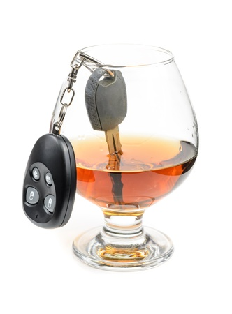 glass of alcohol and car keys. Photo isolated on white background Stock Photo - 17307884