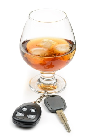 glass of alcohol and car keys. Photo isolated on white background Stock Photo - 17307883