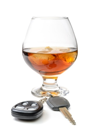 glass of alcohol and car keys. Photo isolated on white background Stock Photo - 17307879