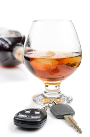 glass of alcohol and car keys. Photo isolated on white background Stock Photo - 17307885