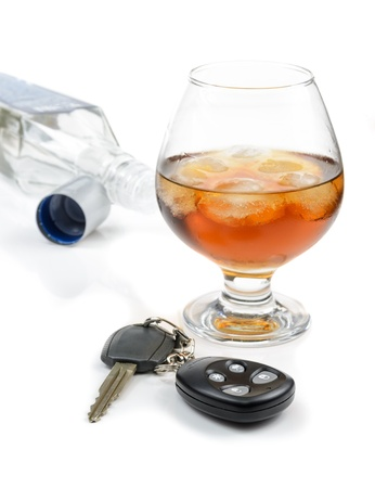 glass of alcohol and car keys. Photo isolated on white background Stock Photo - 17307894
