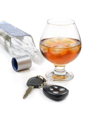 drunk driving: glass of alcohol and car keys. Photo isolated on white background