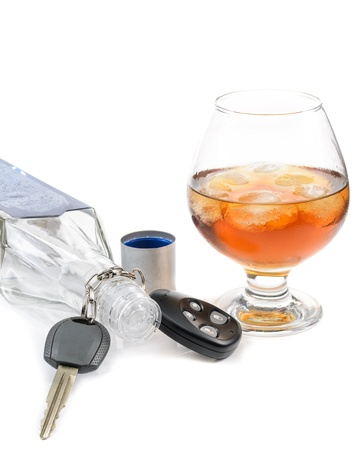 glass of alcohol and car keys. Photo isolated on white background Stock Photo - 17307877