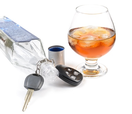 glass of alcohol and car keys. Photo isolated on white background Stock Photo - 17307891