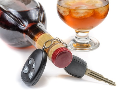glass of alcohol and car keys. Photo isolated on white background Stock Photo - 17307846