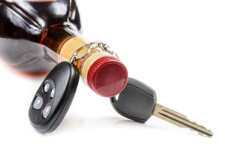 hard drive crash: glass of alcohol and car keys. Photo isolated on white background
