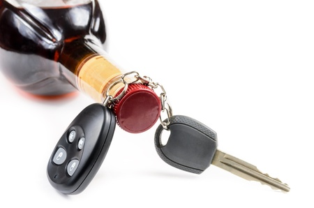 glass of alcohol and car keys. Photo isolated on white background Stock Photo - 17307887