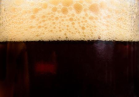 stout: Brasserie foam in the glass. Photo Close-up
