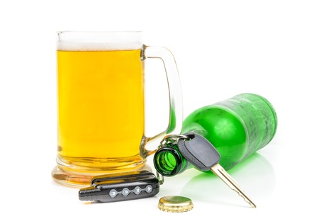 Beer and car keys. The photo on the white background Standard-Bild