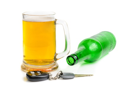 Beer and car keys. The photo on the white background Stock Photo - 17719403