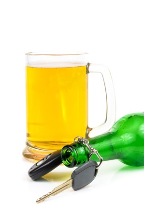 Beer and car keys. The photo on the white background photo