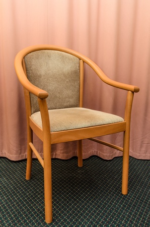 Chair against the curtains. Photo Close-up photo