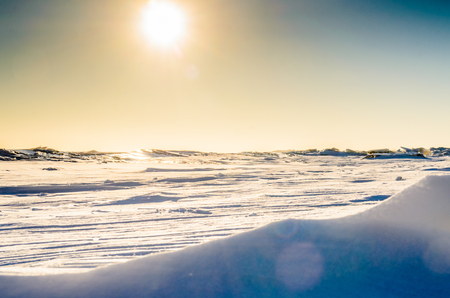 Frozen pond on the sky background. Photo for microstock