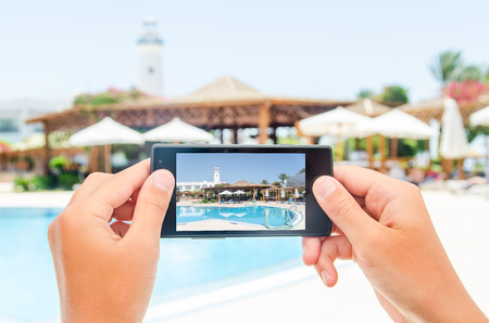Photographing mobile device. Photo for microstock