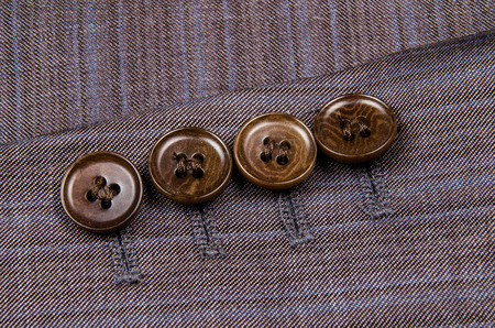 Buttons sleeve of his jacket. Macro photo for microstock
