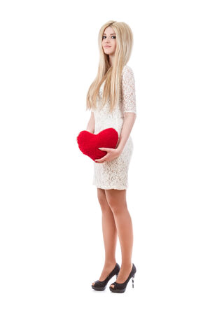 Beautiful smiling blonde woman holding red heart  photo