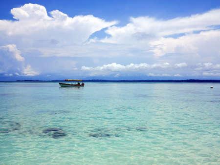 Sailing boat in the calm waters of Slipper Island - Panama