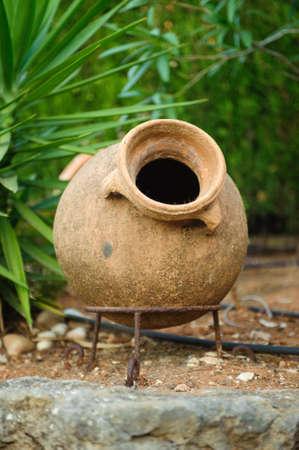 Earthenware jar in garden Spain photo