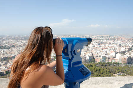 Tourist looking at cityscape on the top of castle tower, Santa Barbara, Alicante Spain