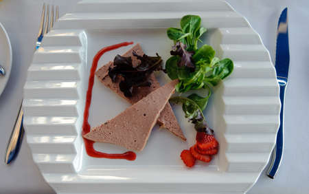 Slices of pate with vegetables photo