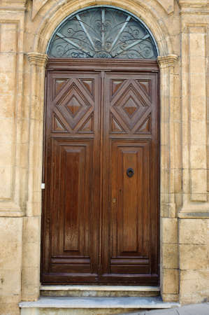 Wooden door in a mediterranean house photo