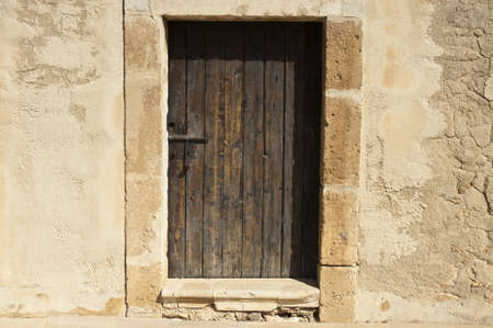 Wooden door in a mediterranean castle photo