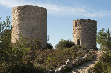 Ancient windmills in Javea, Spain Stock Photo