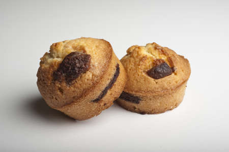 Muffins with chocolate on a wooden table Stock Photo