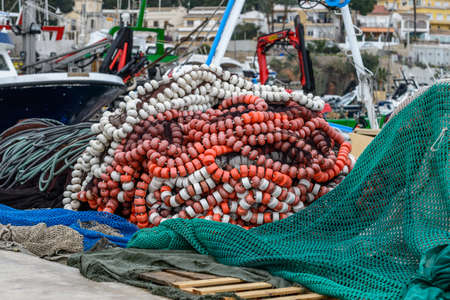 commercial fishing net: Fishing nets on the dock of the port of Javea - Alicante - Spain Stock Photo