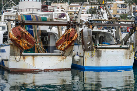Fishing Boats in a Harbour and a Grey Sky photo