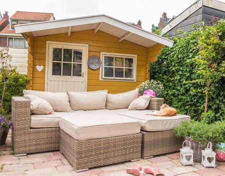 english garden: Garden shed and sofa