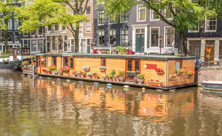 View on a typical canal in Amsterdam, the Netherlands, with houseboats Stock Photo - 18269193