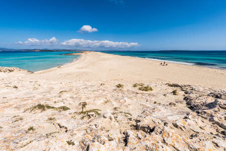 Tourists in Illetes beach Formentera island, Mediterranean sea, Spain