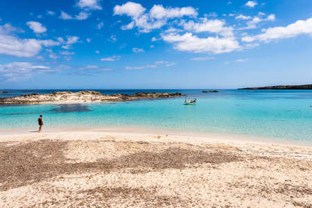 pujols: Tourist visiting Els Pujols beach in Formentera island, Mediterranean sea, Spain