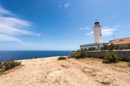 Tourists visiting Formentera La Mota lighthouse mediterranean Sea